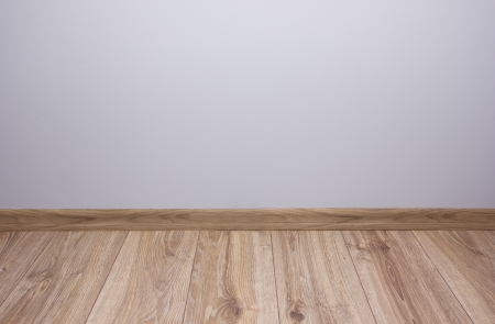 empty room with gray wall and wooden flor photo