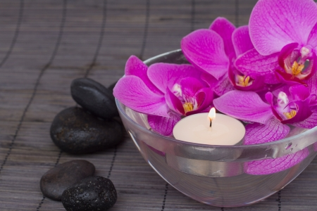 bowl with  orchid with candels and zen stones photo