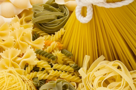 Variety of types and shapes of Italian pasta photo