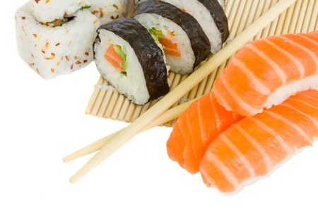 sushi and rolls on bamboo mat  isolated on white background Stock Photo - 15581350