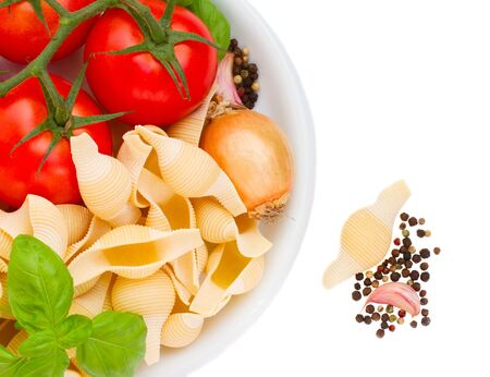 raw italian pasta ingredients in plate isolated on white background Stock Photo - 15642115