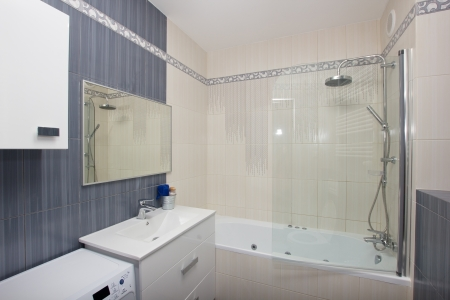 Moder  bathroom in gray and white tiles photo