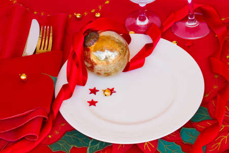 table served for christmas party with red table cloth abd golden ball photo