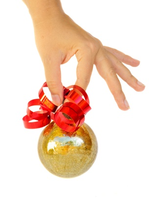 hand holding golden christmas ball isolated on white photo