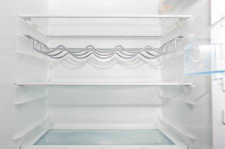 empty white  open fridge with some shelves photo