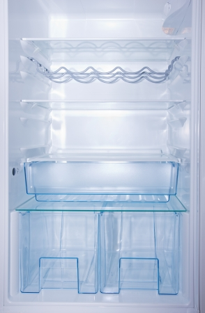 empty white  open fridge with different type of  shelves photo