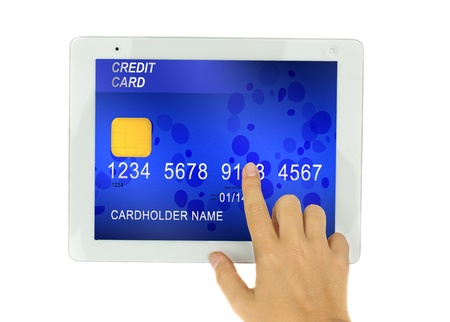 hand pointing at tblet PC  with credit card on display isolated on white background photo