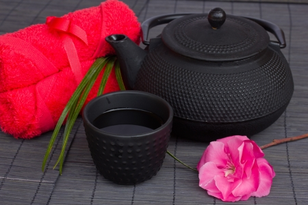 tea set: asian tea set with pink flower and towels Stock Photo