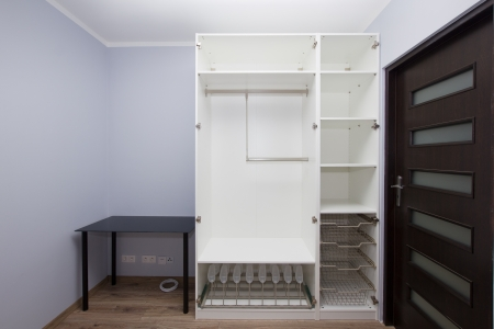 Modern apartment interior with empty white  wardrobe photo