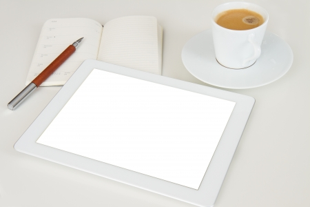 tablet pc with notebook and cup of coffee photo