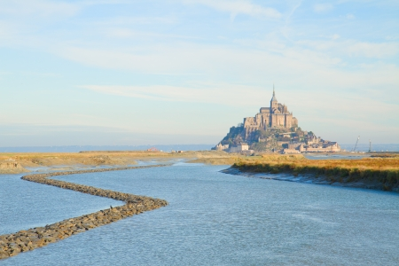 Mont Saint Michel city over sea water,  France photo