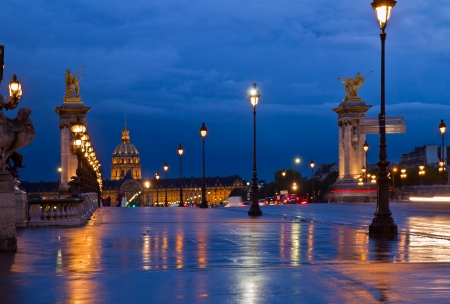 lampposts: Alexandre III Bridge at night,  Paris, France