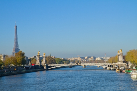 Alexandre III Bridge and Eiffel tower at sunny day,  Paris, France photo