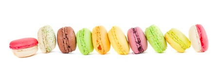 macaroon: row of french multicolored  macaroons isolated on white background Stock Photo