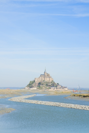 Mont Saint Michel over sea , Nirmandy, France  photo