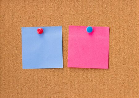 blue and pink empty notes on cork background Stock Photo - 16641493