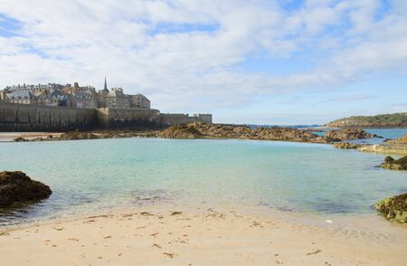 Saint-Malo old city over tidal waters , Brittany, France photo