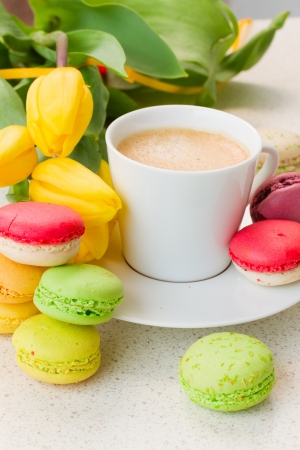 breakfast with coffee, spring tulips and macaroons photo