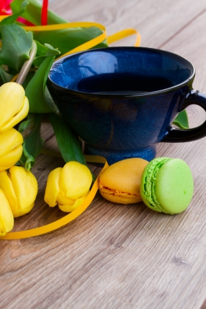 breakfast with tea, spring tulips and macaroons photo