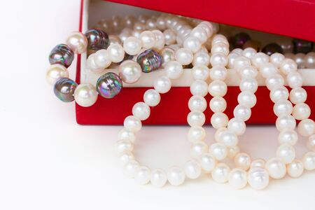pearl strands  in red box on white background photo