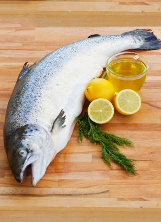 Atlantic Salmon whole on wooden table Stock Photo - 16813669
