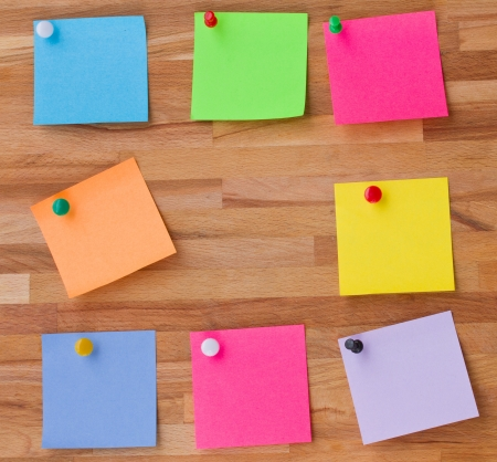colorful sheets of paper on wooden board background Stock Photo - 16813620