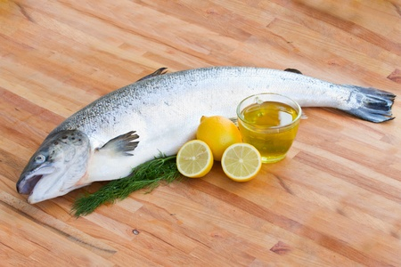 Atlantic Salmon Salmo solar whole fish on wooden table Stock Photo - 16876805