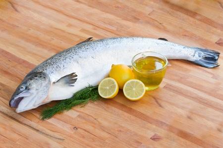 salmo: Atlantic Salmon Salmo solar whole fish on wooden table Stock Photo