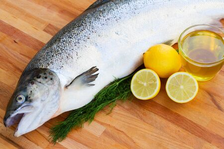 Salmon  fish on wooden table with lemons Stock Photo - 16915078