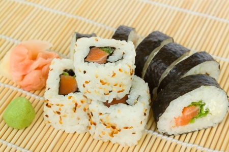 japaneese roll sushi dish served on bamboo mat photo