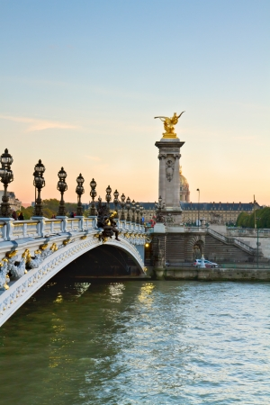 Bridge  of Alexandre III at sunset in Paris, France photo