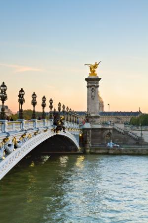 invalides: Bridge  of Alexandre III at sunset in Paris, France Stock Photo