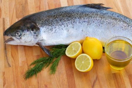 salmo: Atlantic Salmon Salmo solar  raw fish on wooden table