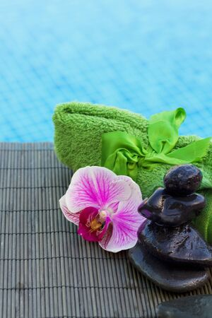 spa stones and flower settings by a pool Stock Photo - 17105833