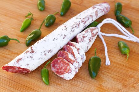Spanish  fuet sausages with green peppers  Delicious traditional mediterranean eating  photo