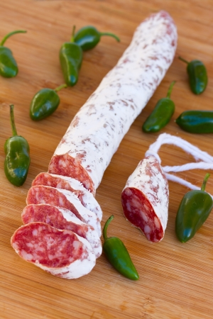 Meat fuet sausages with green peppers  Delicious traditional mediterranean eating  photo
