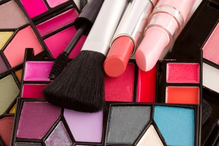 Decorative cosmetics  close up - eye shadows, lipsticks, mascara  Stock Photo - 17105877