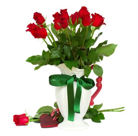 red roses in vase photo