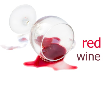 fallen fruit: spilled glass of red wine isolated on white background