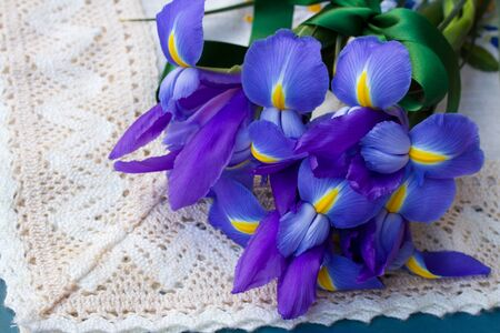 pile  of iris flowers laying on table photo