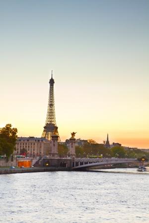 Eiffel tower over Alexandre III Bridgeat at sunset,  Paris, France photo