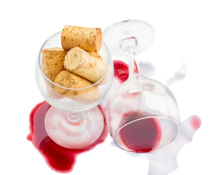 emptied: wine  glasses with corks and wine stains isolated on white background