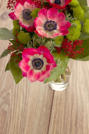 bouquet of  anemone flowers on wooden table photo