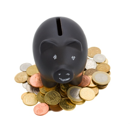 piggy bank with cions isolated on white background photo