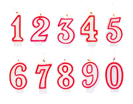 one colour: Burning birthday candles numbers isolated on white background Stock Photo