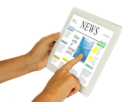 hands holding and pointing at modern tablet PC with news site  isolated on white background with copy space photo