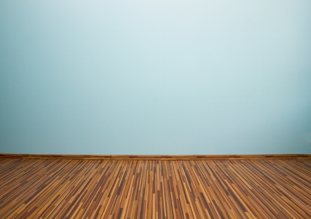 empty room with blue wall and wooden flor photo