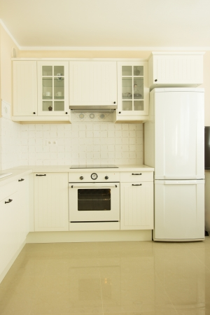 new white  kitchen in antique rustique style photo