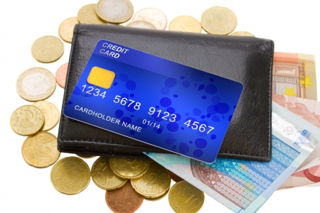 credit card on wallet with banknotes and coins Stock Photo - 18442525