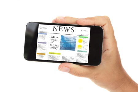 hand holding a modern smartphone with news site isolated on white background with copy space photo